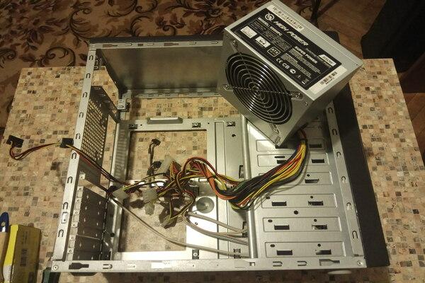 Установка блока питания в корпус компьютера